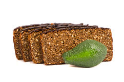 Brown bread with grains slice and avocado on white Stock Image
