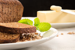 Brown bread with mint and butter Stock Photo