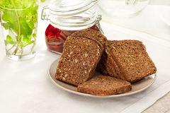 Brown bread with mint and plum compote Royalty Free Stock Photos