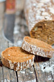 Brown bread on an old wooden table Royalty Free Stock Image
