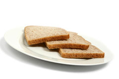 Brown Bread on Plate Stock Photography