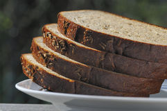 Brown  bread on plate. Brown  bread with sesame  seeds Royalty Free Stock Photography