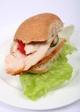 Brown bread roll turkey sandwich Royalty Free Stock Photos