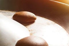 Brown bread on round conveyor. Royalty Free Stock Photography