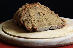 Brown Bread on Round Wooden Tray Stock Images