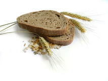 Brown bread, rye ears (spikes) and corn. Healthy, natural, diet food. Isolated royalty free stock image