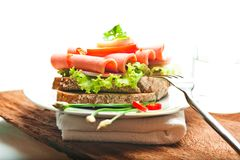 Brown bread with sausage Royalty Free Stock Photography