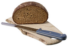Brown bread on shelf with knife Royalty Free Stock Image