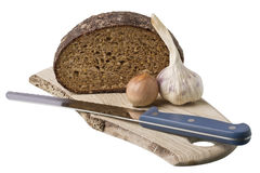 Brown bread on shelf with onion and garlic Stock Photo