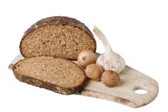 Brown bread on shelf with onion, garlic and walnut Royalty Free Stock Photo