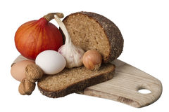 Brown bread on shelf with onion, garlic and walnut Royalty Free Stock Photography