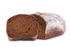 Brown bread with slice Stock Images