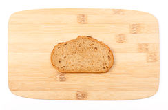 Brown bread slice on bamboo board Royalty Free Stock Image