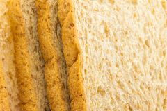 Brown bread slice on white background. Brown bread slice isolated on white background royalty free stock image