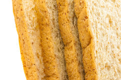 Brown bread slice on white background. Brown bread slice isolated on white background royalty free stock photography