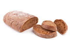 Brown bread with slices stock image