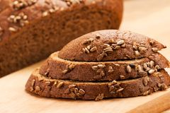 Brown bread slices Stock Photos