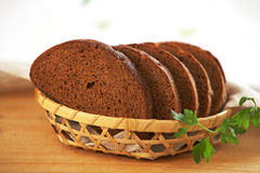 Brown bread slices. In a basket Royalty Free Stock Photography