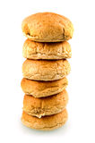 Brown bread stacked. Brown buns stacked and isolated on white background stock images