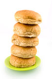 Brown bread stacked on green plate. Isolated on white background royalty free stock images