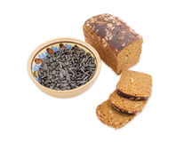 Brown bread and sunflower seeds on a light background Stock Photo