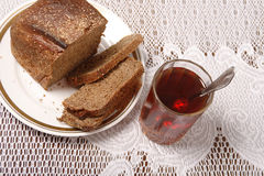Brown bread and tea Royalty Free Stock Photography