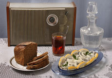 Brown bread, tea, herring, radio Stock Images