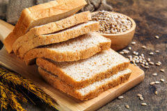 Brown bread and white bread. Slice brown bread and white bread isolated on background stock images