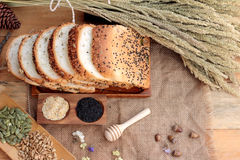 Brown bread with whole grain cereals of sliced and milk. Royalty Free Stock Photography