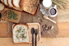Brown bread with whole grain cereals of sliced and milk. Royalty Free Stock Photo