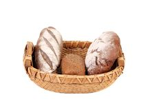 Brown bread in wicker basket. Isolated on a white background Stock Images