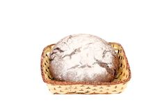 Brown bread in wicker basket. Isolated on a white background Royalty Free Stock Photos