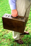 Brown Breifcase. Man outside holding a brown briefcase to the side of him Royalty Free Stock Image