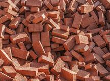 Brown brick building. Close-up of a pile of building bricks Stock Images