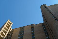 Brown brick high-rise building. Bottom view Stock Photography