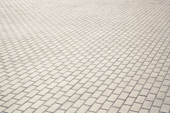 Brown brick stone street road. Light sidewalk Stock Images
