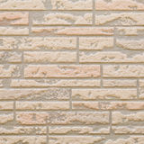 Brown brick stone wall seamless background Stock Image
