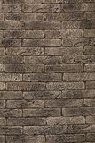 Brown brick texture. Decoration for the exterior, dark brown brick detailed wall, vertical photo Stock Photo