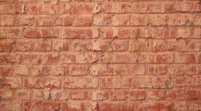 Brown brick wal. Brown brick wall Old brick reddish brown Specific patterns Stock Photo