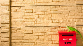Brown brick wall with mailbox isolated  Stock Photo