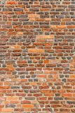 Brown brick wall as grunge background stock photography