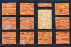 Brown brick wall as grunge background stock image