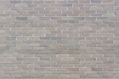 The brown brick wall background texture of modern builing Stock Images