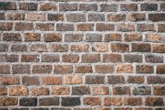 Brown brick wall grunge background royalty free stock photography
