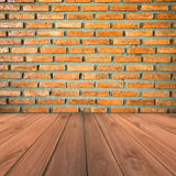 Brown brick wall and grunge wood floor background Royalty Free Stock Images
