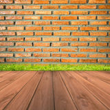 Brown brick wall and grunge wood floor background Stock Images
