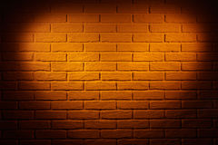 Brown brick wall with heart shape light effect and shadow, abstract background photo Royalty Free Stock Photo