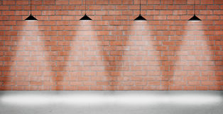 Brown brick wall lightened with four lamps Stock Images
