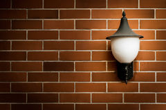 Brown brick wall and old lamp. with vintage filter. Stock Photo