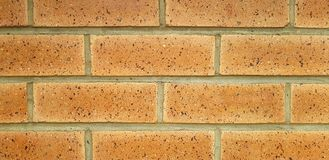 Brown Brick Wall Pattern - Burnt Bricks Background stock photo
